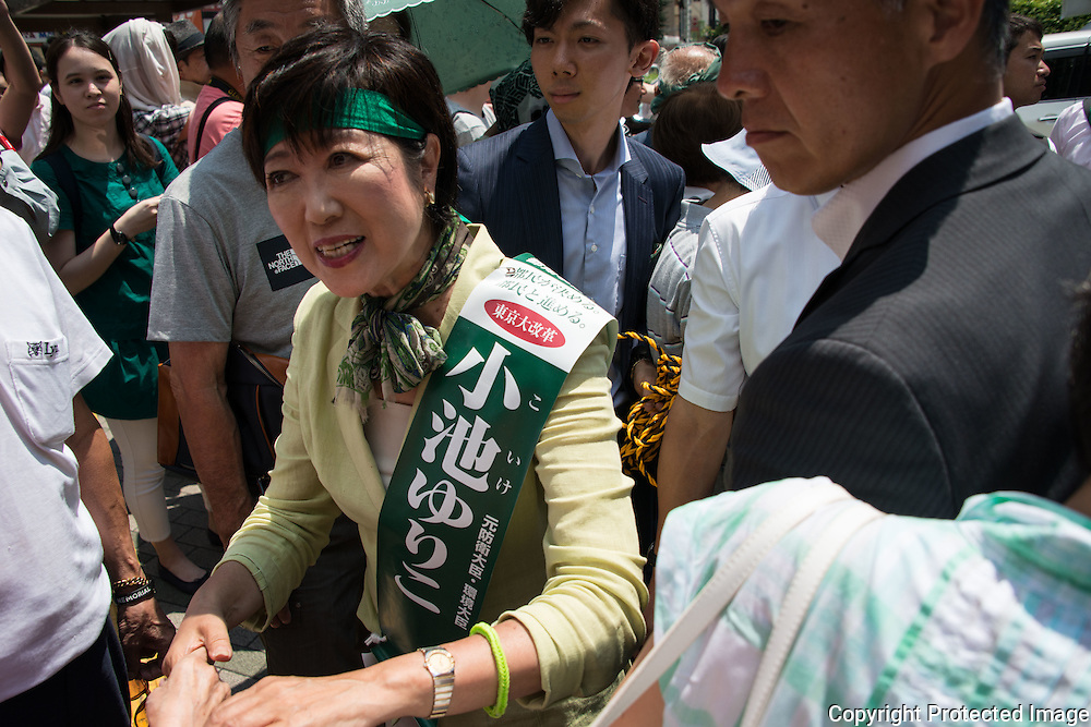 """Yuriko Koike, a Liberal Democratic Party lawmaker and former defense minister greets people before she deliver her speech campaign for the July 31 Tokyo gubernatorial election in front of Meguro Station in Tokyo, Japan on Friday, July 29, 2016. One of Yuriko's slogan for Tokyo is """"Women, men, children, senior, people with disabilities can have a lively life in the city of Tokyo and to be active"""". 29/07/2016-Tokyo, JAPAN"""