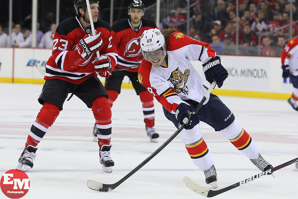Mar 23, 2013; Newark, NJ, USA; Florida Panthers right wing Peter Mueller (88) shoots the puck during the second period at the Prudential Center.
