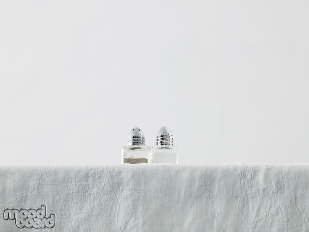 Salt and pepper shakers on table low angle view studio shot