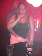 EXCLUSIVE<br /> still the sex continues in Mgaluf <br /> <br /> Uk holiday makers still ignore the no sex in clubs and bar rules and as you can see from our Exclusive pictures its still going on in clubs bars , beaches<br /> <br /> Photo shows; Young brit couple perform a sex act while she carries on drinking in a crowded nightclub<br /> ©Exclusivepix
