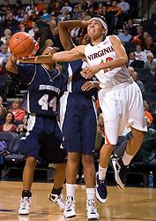 Virginia guard Britnee Millner (12) shoots a baseline layup against MU. The Virginia Cavaliers women's basketball team defeated the Monmouth Hawks 71-45 at the John Paul Jones Arena in Charlottesville, VA on December 18, 2008.