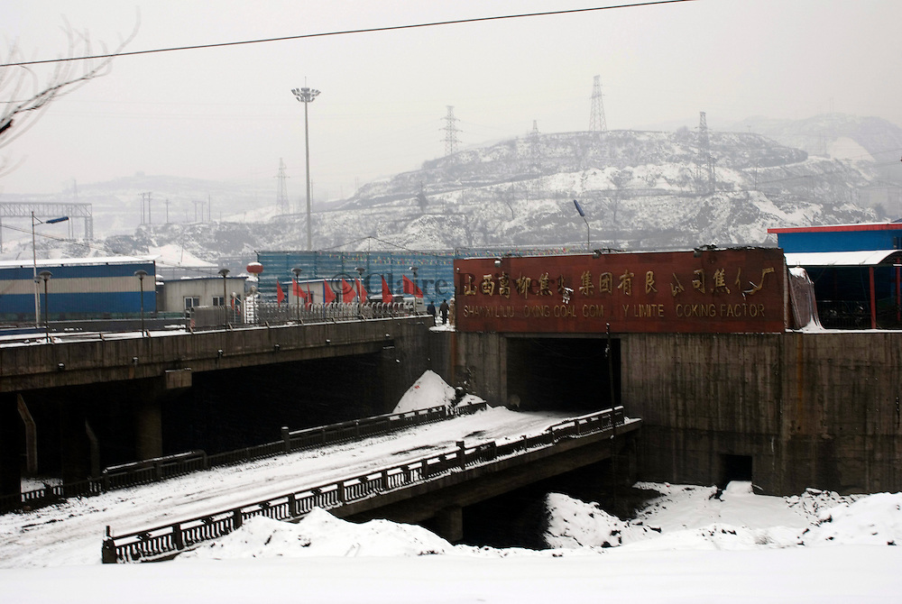 Coking factory's entrance. Shanxi Province is China's largest coal supplier: 500 millions of tonnes per year. This Province is also the most polluted of China. Polluting enterprises are mainly in industrial sectors such as coal, power, metallurgy, chemistry, coking and building materials.