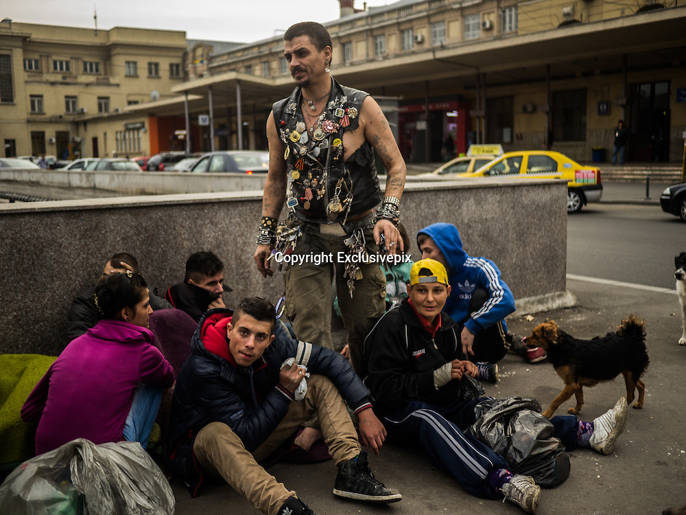 Life UNDER the streets: How the diseased and destitute are forced to carve out a grim existence in the sewers of Eastern Europe<br /> <br /> Once dubbed 'The Paris of the East', Romanian capital Bucharest is a city teeming with ornate architecture, Baroque palaces and tree-lined boulevards.<br /> But beneath its mansions and squares lies a second city that no tourist gets to see - an underground kingdom of outcasts and drug addicts living in the city's vast network of sewers.<br /> Here, everyone is HIV-positive and a quarter have TB, yet they are left to rot in the darkness, huddling against heating pipes and snorting glue to stay warm.<br /> <br /> <br /> At the head of this city of vice is one man, named Bruce Lee from his street-fighting days. A father, mentor and drug-dealer to all, he brings safety - and a bottomless supply of glue - to the 'sewer children' of Bucharest, many of whom have lived there since the fall of Communism two decades ago.<br /> Now this underground society is exposed in a new film by Channel 4 News' Paraic O'Brien, Jim Wickens &amp; Radu Ciorniciuc.<br /> This is their dispatch.<br /> <br /> <br /> We're standing outside Bucharest's Gara de Nord, in the pouring rain, waiting for an invitation. You can travel to the heart of the EU from this train station but our journey will take us just a few metres.&nbsp;<br /> On the surface, the newest member to the European club has worked hard to redefine itself. But there's a another Romania, underground.<br /> <br /> When Ceausescu fell there were tens of thousands of children in orphanages and in state 'care' in Romania. But in 1990 a series of reports revealed what a nightmarish misnomer that was. Scenes of neglect and cruelty on our televisions, reminiscent of the concentration camps.&nbsp;<br /> So what happened to those children? We've been told that some moved into the tunnels underneath Bucharest, drug addiction was rife, some had had children of their own.<br /> <br /> The entrance to thi