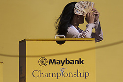 February 3, 2018 - Shah Alam, Kuala Lumpur, Malaysia - A lady is seen hiding his face from the striking sunshine at hole no 3 on Maybank Championship 2018...The Maybank Championship 2018 golf event is being hosted on 1st to 4th February at Saujana Golf & Country Club. (Credit Image: © Faris Hadziq/SOPA via ZUMA Wire)
