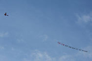 An airplane towing a banner opposing Republican Vice Presidential candidate  Rep. Paul Ryan's Medicare plan flies overhead before a campaign rally with Ryan on Saturday, August 18, 2012 in The Villages, FL.