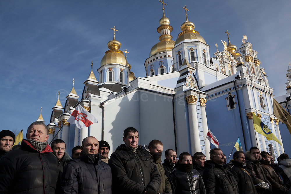 Funeral of protester Mikhail Zhiznevsky that was killed during previous days clashes with riot police. Mourners gathered inside Saint Michael Cathedral compound, in Kiev, 26 January 2014.
