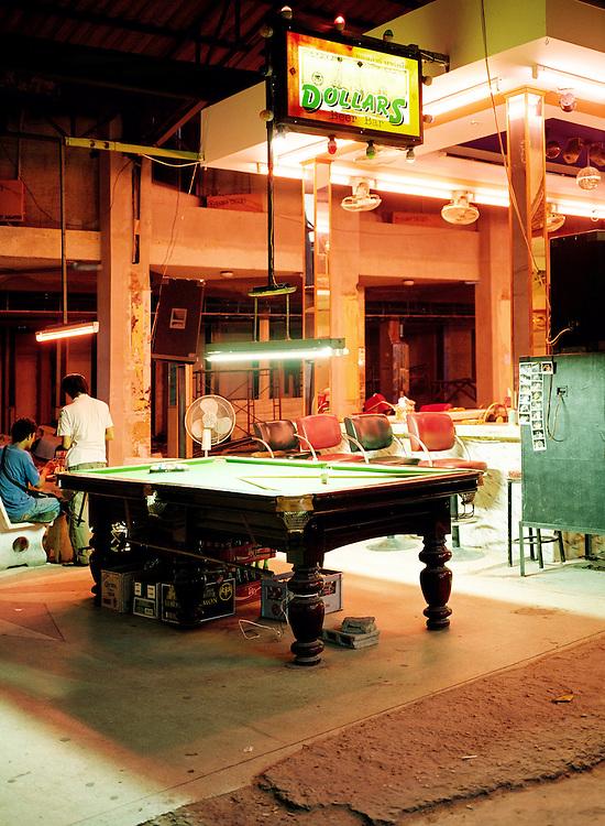 A quiet night at the billiard (pool) hall.