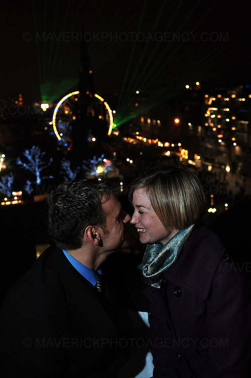 EDINBURGH, UK. Adam Philp (26) proposed to his girlfriend Vicky Ward (23) on the roof of the Balmoral Hotel in Edinburgh after the fireworks display bringing in the new year. Fortunately Vicky said yes! Both Adam and Vicky are staff at the Balmoral Hotel...Adam - 07968 498 591 or Vicky - 07851 597 194 for more information on the couple...Picture Richard Scott/Maverick