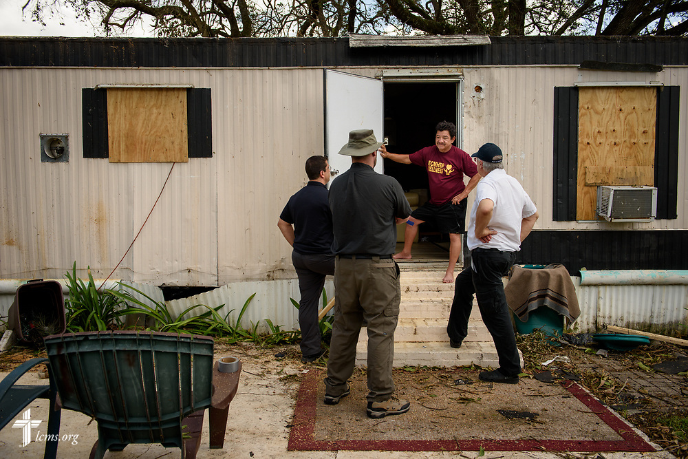 Martin Robles visits with the Rev. Bob Selle of Amigos en Cristo Lutheran Mission, the Rev. Dr. Ross Johnson, director of LCMS Disaster Response, and the Rev. Michael Meyer, manager of LCMS Disaster Response, at his hurricane-damaged home on Wednesday, Sept. 13, 2017, in Immokalee, Fla. Robles attends Amigos En Cristo Immokalee Lutheran Mission. LCMS Communications/Erik M. Lunsford