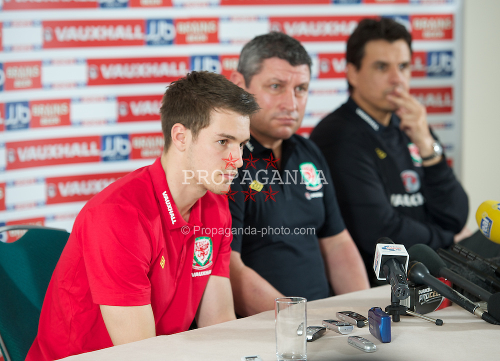 CARDIFF, WALES - Monday, February 27, 2012: Wales' captain Aaron Ramsey, coach Osian Roberts and manager Chris Coleman at a press conference ahead of the friendly match against Costa Rica. (Pic by David Rawcliffe/Propaganda)