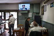 People vaguely listen in a Barcelona restaurant to a televised announcement by Carles Puigdemont from Brussel on October 31, 2017 in Barcelona, Spain. Catalonia's dismissed president Carles Puigdemont has announced from Belgium that he is not seeking asylum, after declaring independence from Spain last week. Four days ago Catalan parliament voted Catalonia independence and Spanish government retaliated by imposing direct rules, dissolving parliament, firing top officials. October 30, 2017 in Barcelona, Spain.