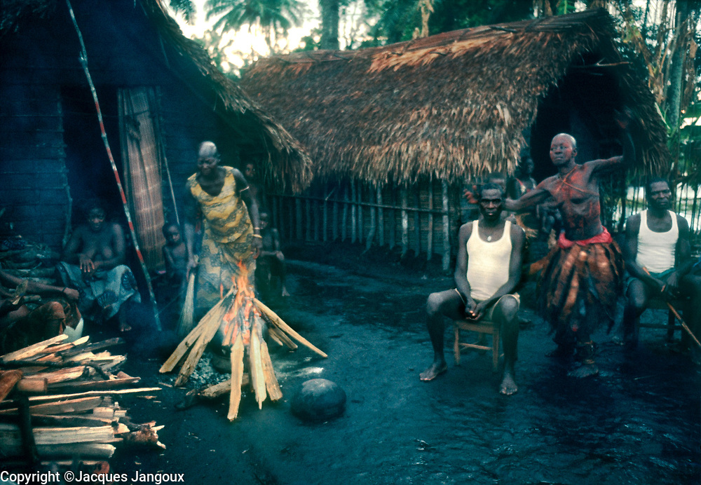Africa, Libinza tribe, Ngiri River islands, Democratic Republic of the Congo. Woman diviner performing a curing ceremony.