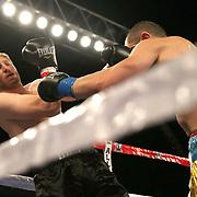 Arman Rysbek (R) fights against John Morehouse during a Telemundo boxing match between at Osceola Heritage Park on Friday, February 23, 2018 in Kissimmee, Florida.  (Alex Menendez via AP)