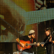 Rising artist Levi Lowrey fiddles alongside country star Zac Brown during Saturday's Fun Fest Sunset Concert Series show at J. Fred Johnson Stadium.