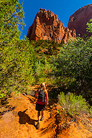 Woman hiking on the Taylor Creek Trail, Kolob Canyon, Zion National Park, Utah, USA.