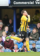 Shrewsbury Town striker Bobby Grant scores to make it 2-0 to Shrewsbury during the Sky Bet League 2 match between Portsmouth and Shrewsbury Town at Fratton Park, Portsmouth, England on 28 March 2015.