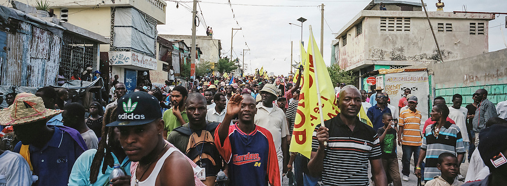 Anti-government protesters march through the streets on Tuesday, December 16, 2014 in Port-au-Prince, Haiti. President Michel Martelly was elected in 2010 with great hope for reforms, but in the wake of slow recovery and parliamentary elections that are three years overdue, his popularity has suffered tremendously, forcing Prime Minister Laurent Lamothe to resign.