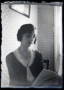 adult woman reading indoors circa 1930s