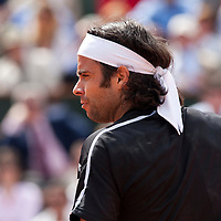 5 June 2009: Fernando Gonzalez of Chile looks dejected during the Men's Singles Semi Final match on day thirteen of the French Open at Roland Garros in Paris, France.