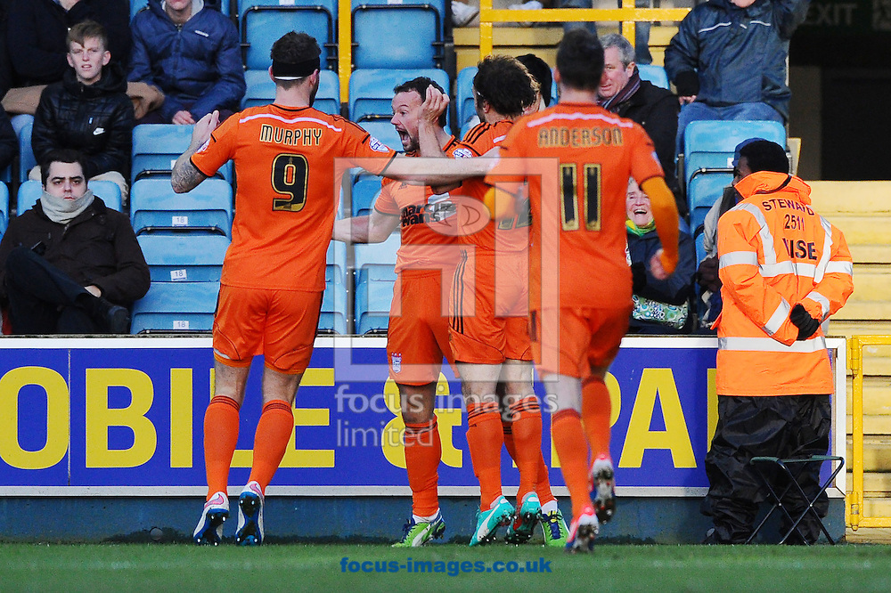 Noel Hunt of Ipswich Town (second left) celebrates with teammates after scoring the opening goal during the Sky Bet Championship match at The Den, London<br /> Picture by Seb Daly/Focus Images Ltd +447738 614630<br /> 17/01/2015