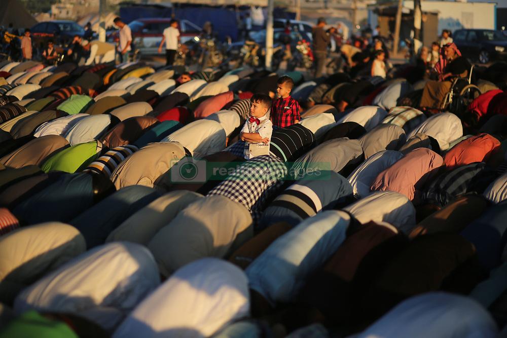 June 15, 2018 - Gaza, Palestinian Territories, Palestine - Palestinians attend Eid al-Fitr prayers in Khan Younis in the southern Gaza Strip. (Credit Image: © Majdi Fathi/NurPhoto via ZUMA Press)