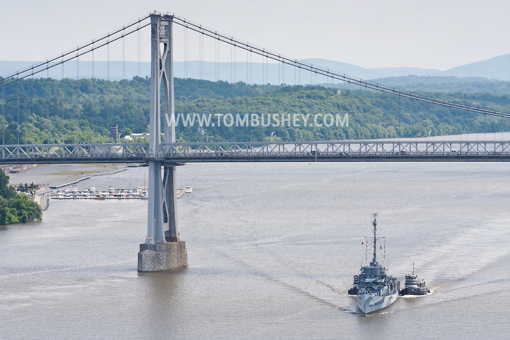 Highland, New York - The USS Slater passes under the Mid-Hudson Bridgeon its way north on the Hudson River on June 30, 2014. The Slater served in World War II and is the last destroyer escort vessel afloat in America. The Slater was on the way to Albany, N.Y., to resume its duties as a floating museum.