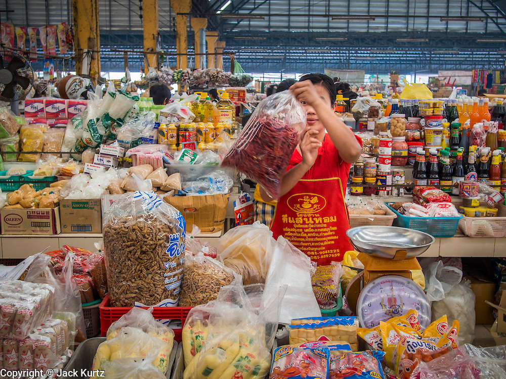 07 MARCH 2014 - MAE SOT, TAK, THAILAND: A Burmese woman packages chilies for sale in the Burmese market in Mae Sot.     PHOTO BY JACK KURTZ
