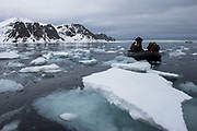 Tourists in Zodiac<br /> Spitsbergen<br /> Svalbard<br /> Norway<br /> Arctic Ocean