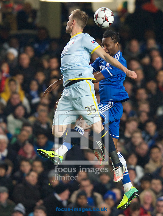 Picture by Alan Stanford/Focus Images Ltd +44 7915 056117<br /> 11/12/2013<br /> John Obi Mikel of Chelsea challenges for the header with Pantelis Kapetanos of Steaua Bucharest during the UEFA Champions League match at Stamford Bridge, London.