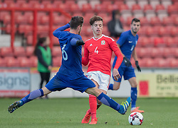 WREXHAM, WALES - Thursday, November 10, 2016: Wales' Jack Evans in action against Stathis Lamprou Greece during the UEFA European Under-19 Championship Qualifying Round Group 6 match at the Racecourse Ground. (Pic by Gavin Trafford/Propaganda)
