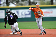 MANHATTAN, KS - APRIL 26:  Shortstop David Hernandez #39 of the Texas Longhorns throws to first base over Justin Bloxom #9 of the Kansas State Wildcats for an inning ending double play in the fifth inning on April 26, 2008 at Tointon Stadium in Manhattan, Kansas.  Kansas State defeated Texas 4-1.  (Photo by Peter Aiken/Getty Images)