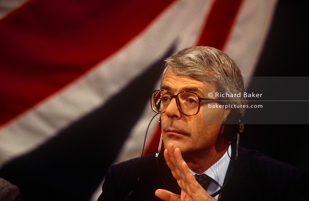 With a Union jack flag behind, British Prime Minister, John Major during the joint press conference with Chancellor Helmut Kohl, during the Anglo-German summit on 11th November 1992 at Heythrop Park in Oxfordshire, England.