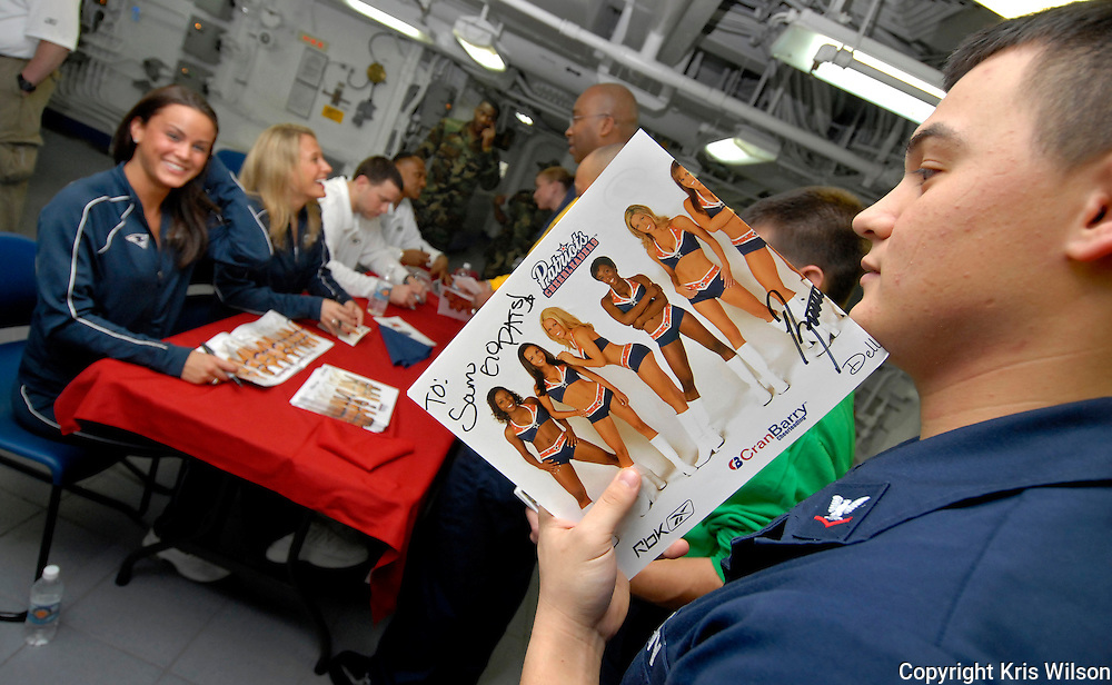 Sailors stand in line in the forward mess decks to get the chance to meet and get autographs from New England Patriots cheerleaders and players from the Green Bay Packers on board Nimitz-class aircraft carrier USS Harry S. Truman (CVN 75).