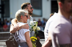 © Licensed to London News Pictures. 03/06/2018. London, UK. Members of the public look emotional as they gather for a minutes silence for the victims of the 2017 London Bridge Terror attack, held on London Bridge. Eight people were killed and 48 were injured when a van was deliberately driven into pedestrians on London Bridge. Three occupants then ran to the nearby Borough Market area carrying knives and fake explosives. Photo credit: Ben Cawthra/LNP