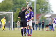 City of Liverpool's (purple) Jamie McDonald gets the yellow card for his tackle on  Litherland's Stephen Ferrigan  during the North West Counties League Play Off Final match between Litherland REMYCA and City of Liverpool FC at Litherland Sports Park, Litherland, United Kingdom on 13 May 2017. Photo by Craig Galloway.