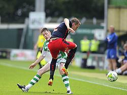 Yeovil Town's Andy Welsh battles for the ball with Reading's Chris Gunter - Photo mandatory by-line: Joe Meredith/JMP - Mobile: 07966 386802 19/07/2014 - SPORT - FOOTBALL - Yeovil - Huish Park - Yeovil Town v Reading