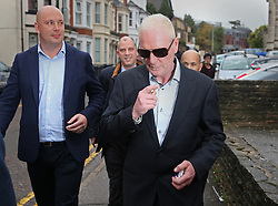 © Licensed to London News Pictures. 29/10/2015. Bournemouth, UK. Paul Gascoigne (R) leaves Bournemouth Magistrates Court after pleading guilty to harassment and assault charges. Photo credit: Peter Macdiarmid/LNP