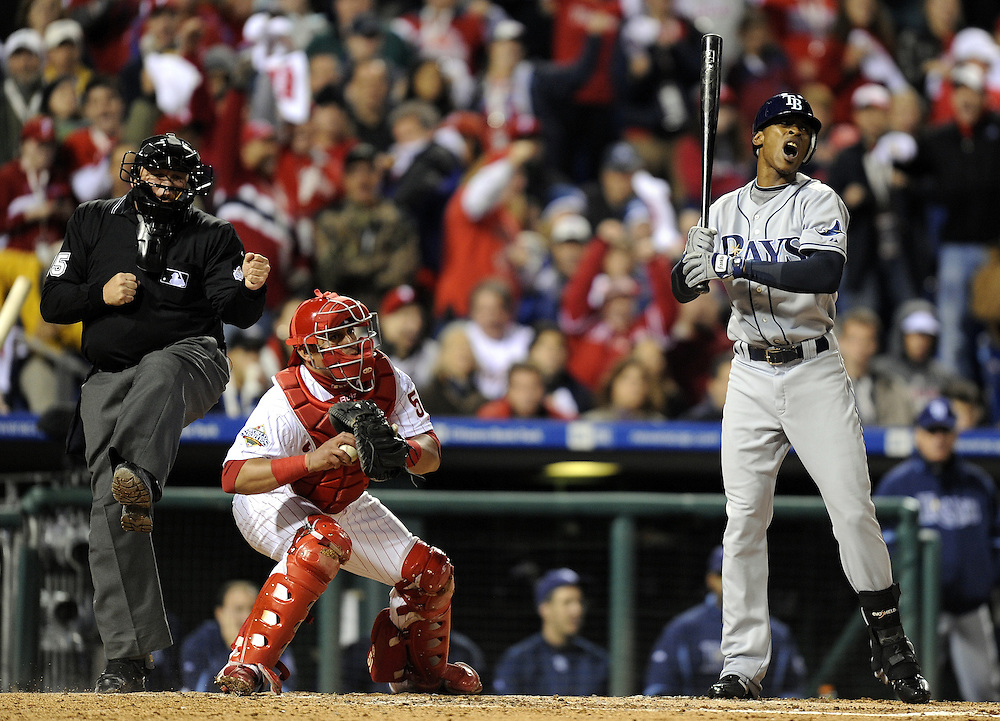 Tampa Bay Rays batter B.J. Upton (R) reacts as home plate umpire Fieldin Culbreth (L) calls him out on strikes as Philadelphia Phillies catcher Carlos Ruiz (C) holds the ball in the top of the third inning of game three of the 2008 World Series  at Citizens Bank Park in Philadelphia, Pennsylvania, USA 25 October 2008.  The best-of-seven series is tied 1-1.