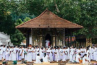 Kandy, Sri Lanka -- January 31, 2018: Crowds gather outside the Temple of the Tooth for free breakfast on Poya Day.