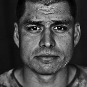 U.S. Marine Gysgt. Julian Lumm age 31 who is part of Alpha Company of the 24th Marine Expeditionary Unit (MEU) Battle Landing Team (BLT) 1/6, after building an Observation Post with sand bags in Garmsir District, Helmand Province, Afghanistan at Forward Operating Base Apache North. Located in Southern Helmand Province, Garmsir has been a haven for insurgents for the last several years. Earlier this year the Marines cleared the area after a period of heavy fighting. Julian is from Tucson AZ and he has done two previous tours of Afghanistan and two of Iraq.