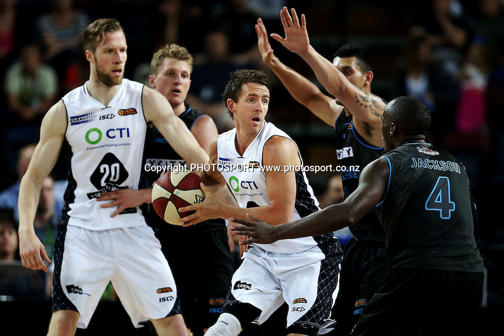 Daryl Corletto of Melbourne United is pressured by Cedric Jackson and Duane Bailey of the Breakers. 2014/15 ANBL, SkyCity Breakers vs Melbourne United, Vector Arena, Auckland, New Zealand. Friday 21 November 2014. Photo: Anthony Au-Yeung / photosport.co.nz