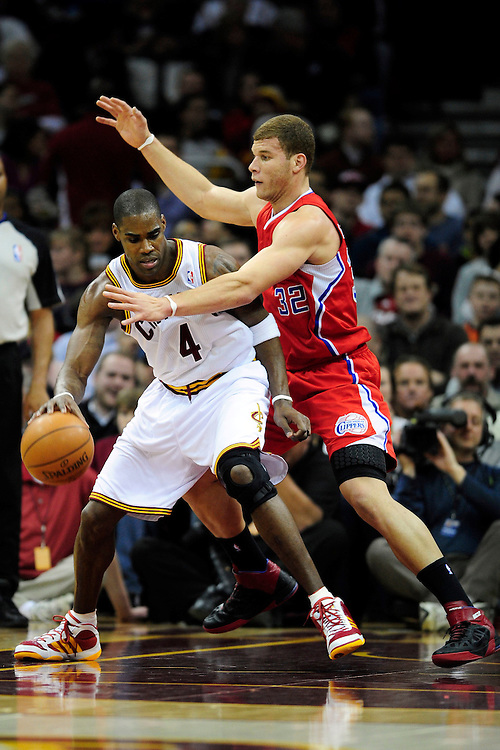 Feb. 11, 2011; Cleveland, OH, USA; Cleveland Cavaliers power forward Antawn Jamison (4) posts up against Los Angeles Clippers power forward Blake Griffin (32) during the first quarter at Quicken Loans Arena. Mandatory Credit: Jason Miller-US PRESSWIRE