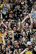 SHOT 3/7/13 8:06:51 PM - Colorado basketball fans celebrate the team's first points against Oregon by throwing confetti during their Pac-12 Conference regular season basketball game at the Coors Events Center on the University of Colorado campus in Boulder, Co. Colorado won the game 76-53..(Photo by Marc Piscotty / © 2013)