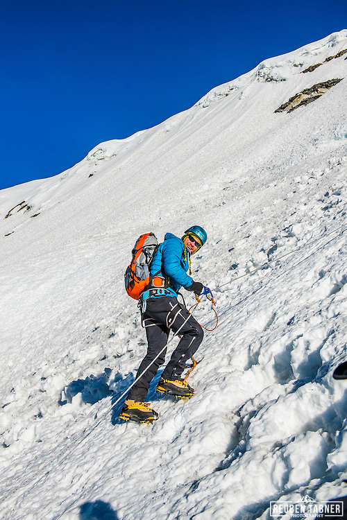 A climber uses an ascender on the main ice wall leading to the summit of Island Peak.