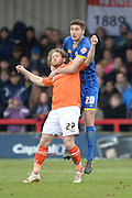 Ryan Sweeney of AFC Wimbledon and Luton Town striker Craig Mackail-Smith  during the Sky Bet League 2 match between AFC Wimbledon and Luton Town at the Cherry Red Records Stadium, Kingston, England on 13 February 2016. Photo by David Vokes.