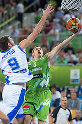 Jaka Lakovic #5 of Slovenia lays the ball up against Antonis Fotsis #9 of Greece during basketball match between national team of Greece and Slovenia at Eurobasket 2013 on September 14, 2013 in SRC Stozice, Ljubljana, Slovenia. (Photo By Matic Klansek Velej / Sportida.com)