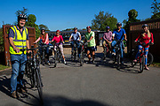 A group of cyclists stand with their electric bikes before starting a tour at the UK Electric Bike Centre, Staplehurst, Kent, England, UK.  (photo by Andrew Aitchison / In pictures via Getty Images)