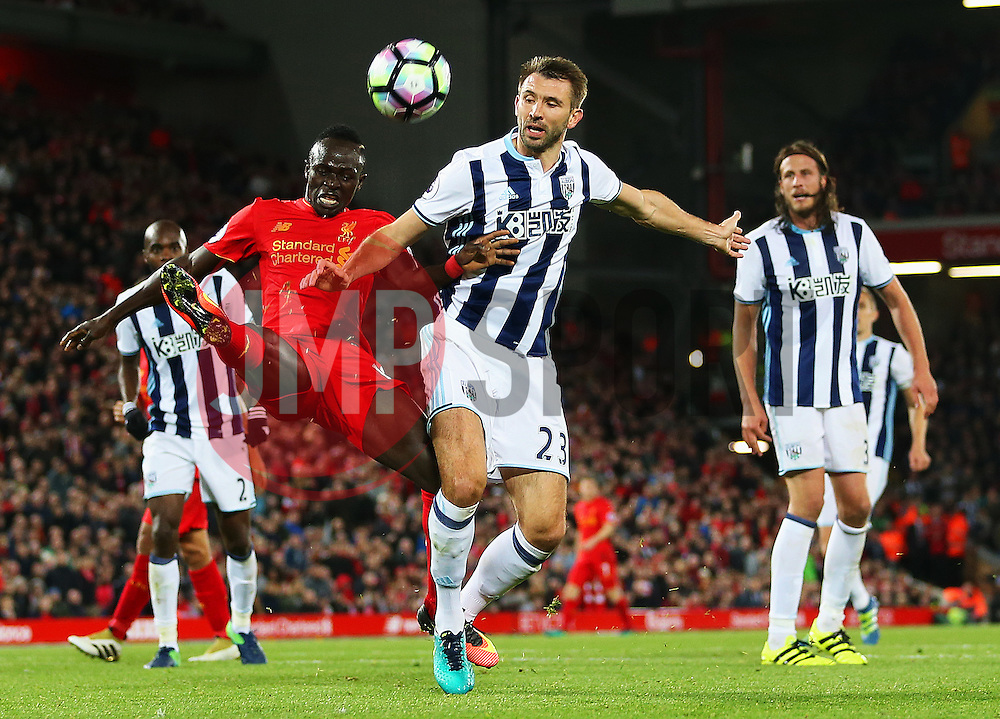 Sadio Mane of Liverpool challenges Gareth McAuley of West Bromwich Albion - Mandatory by-line: Matt McNulty/JMP - 22/10/2016 - FOOTBALL - Anfield - Liverpool, England - Liverpool v West Bromwich Albion - Premier League
