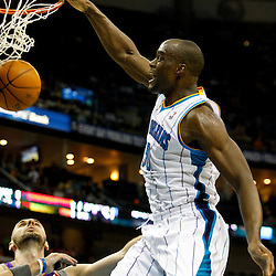December 30, 2011; New Orleans, LA, USA; New Orleans Hornets center Emeka Okafor (50) dunks over Phoenix Suns center Marcin Gortat (4) during the second quarter of a game at the New Orleans Arena.   Mandatory Credit: Derick E. Hingle-US PRESSWIRE