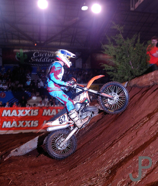 #52 Kyle Redmond from Kaje Hughs, CA compresses his suspension on his KTM as he climbs the face of one of the many obstacles at the 2007 Maxxis AMA Endurocross at the Lazy E Arena in Guthrie, Oklahoma.  Event was won by David Knight #101 on KTM
